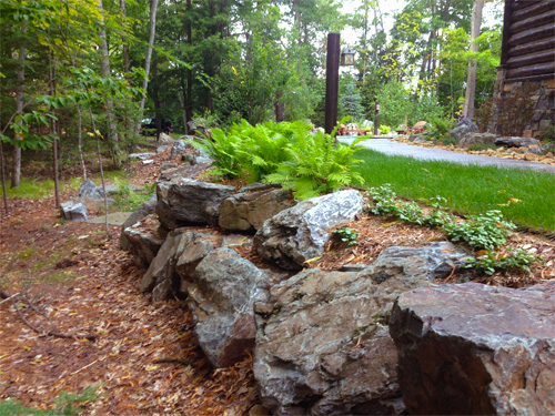 Retaining walls custom landscaping for Natural rock landscaping